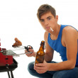 Smoking young man grilling chiken - Photo