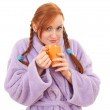 Young woman in bathrobe with big cup — Stock fotografie