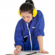 Woman in coveralls with clipboard - Foto de Stock