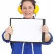 Woman in coveralls with clipboard - Stock Photo
