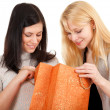 Two young women and gift bag - Foto de Stock