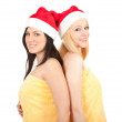 Two Christmas women in yellow towel — 图库照片