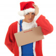 Man in Santa clothes with blank card — Stock Photo