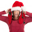 Woman in Santa hat keeping red socks — Stock Photo #4407696