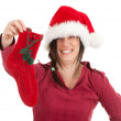 Woman in Santa hat keeping red sock — Stock Photo #4407701