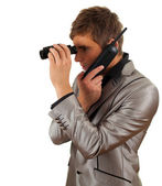 Calling spy man using binoculars — Stock Photo