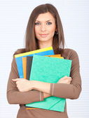 Smiling student lady with note pads — Stock Photo