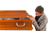 Man with coffin — Stock Photo
