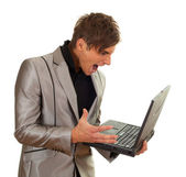 Angry young man with laptop — Stock Photo