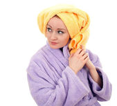 Woman in bathrobe and towel on head — Stock Photo