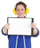 Woman in coveralls with clipboard — Stock Photo