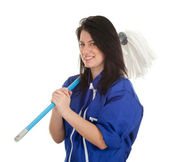 Woman in overalls with mop — Stockfoto
