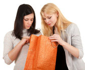Two young women and gift bag — Stock Photo