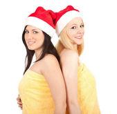 İki noel kadın sarı havlu — Stok fotoğraf