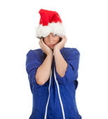 Suffering from pain woman in Santa hat — Stock Photo