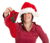 Woman in Santa hat keeping red sock — Stock Photo