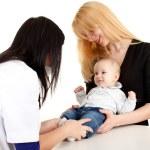 Female doctor examining baby boy — Stock Photo