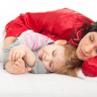 Little girl with mother in bedding — Stock fotografie #4435226