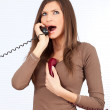 Angry woman speaking on the phone - Stockfoto