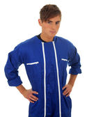 Standing man in blue coveralls — Stock Photo