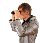 Spy man using binoculars — Stock Photo