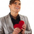 Loving man with red hart - Stock Photo