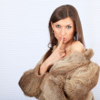 Beautiful woman in a fur coat — Stock Photo #4549428