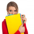 Stock Photo: Student womwith note pad