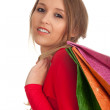 Young woman & coloured shopping bags — Stock Photo #4549479
