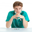 Stock Photo: Sitting doctor with stethoscope