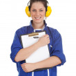 Womin coveralls with clipboard — Stock Photo #4549675