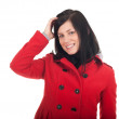 Beautiful woman in red coat — Stok fotoğraf