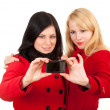Two women with camera - Stock Photo