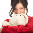 Smiling woman with teddy bear — Stock Photo