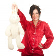 Smiling woman with plush rabbit — Stock Photo #4549693