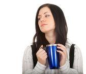Jonge vrouw met grote blauwe kop — Stockfoto