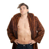 Young man in a fur coat — Stockfoto