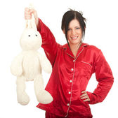 Smiling woman with plush rabbit — Stock Photo