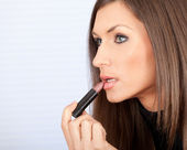 Woman with lipstick — Stock Photo