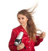 Ung kvinna torkning håret — Stockfoto