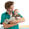 Stock Photo: Male doctor examining baby boy