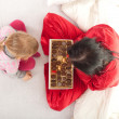 Little girl and woman with chocolate box - Stok fotoğraf