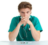 Sitting doctor with stethoscope — Stockfoto