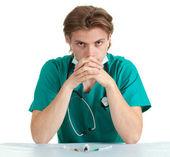 Vergadering arts met een stethoscoop — Stockfoto