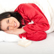 Womanwith present box in bedding - Stock Photo