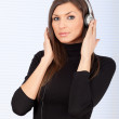 Young woman in headphones — Stock Photo
