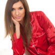 Young woman in red pajamas — Stock Photo #4621109