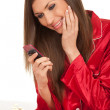 Woman in red pajamas with phone — Stock Photo #4621136