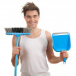 Stock Photo: Mwith sweeping brush