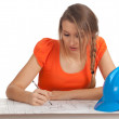 Female architect reading blueprints — Stock Photo #4621393